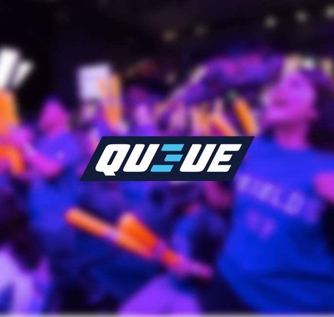 QU3UE Logo on a blurred image of an esports crowd