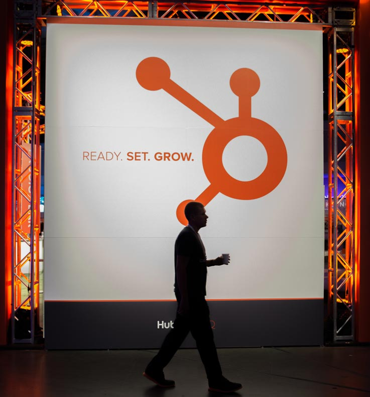 HubSpot photo from Inbound conference of man walking past the sign that says: Ready set grow.